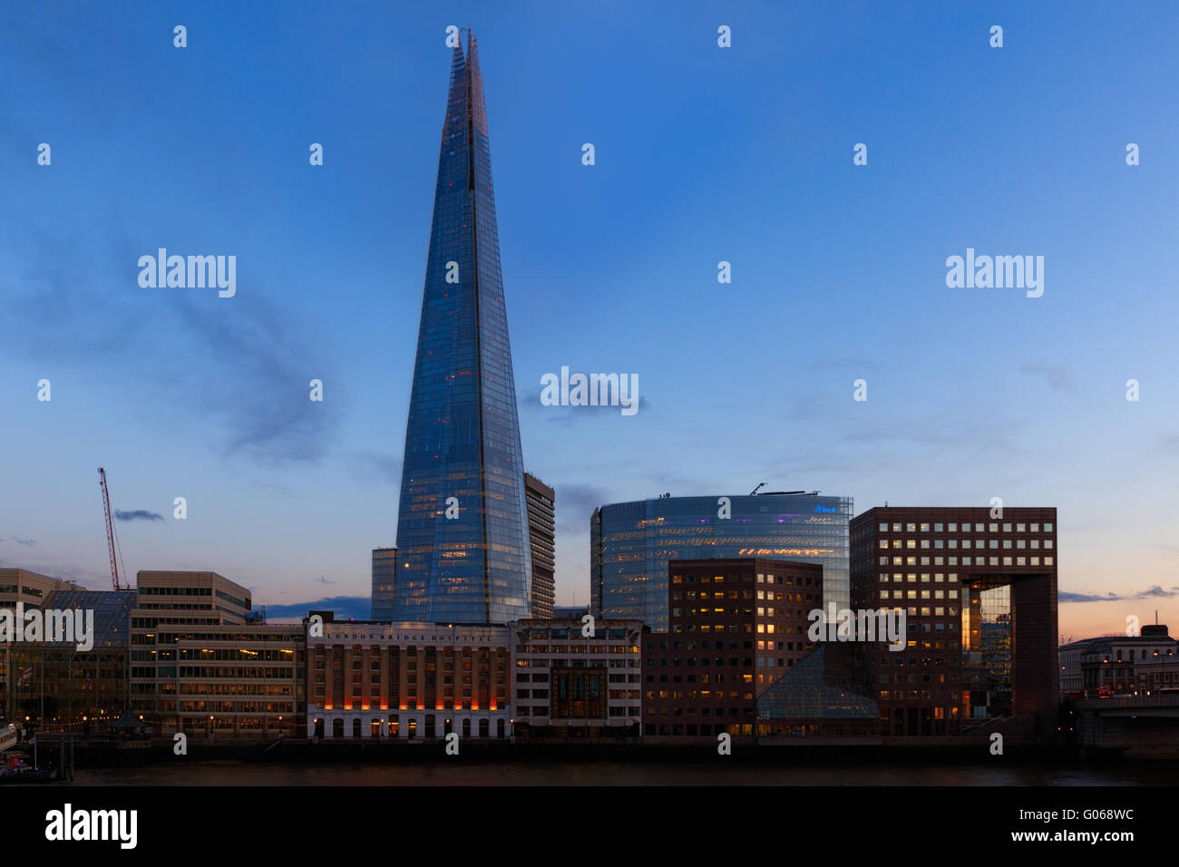 Sunset on the London skyline showing The Shard and office buildings - Stock Image