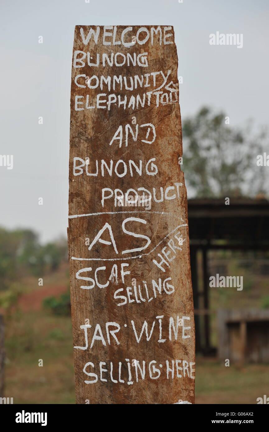 Bunong hilltribe sign advertising elephant & jungle trekking, Mondulkiri Province, Cambodia. credit: Kraig Lieb - Stock Image