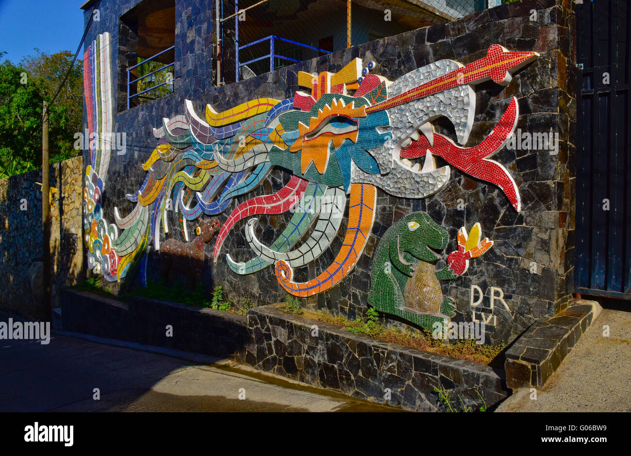 Diego Rivera designed tiled mosaic mural (Ehecatl-Calle) along the street in front of the Dolores Olmeda home in Stock Photo
