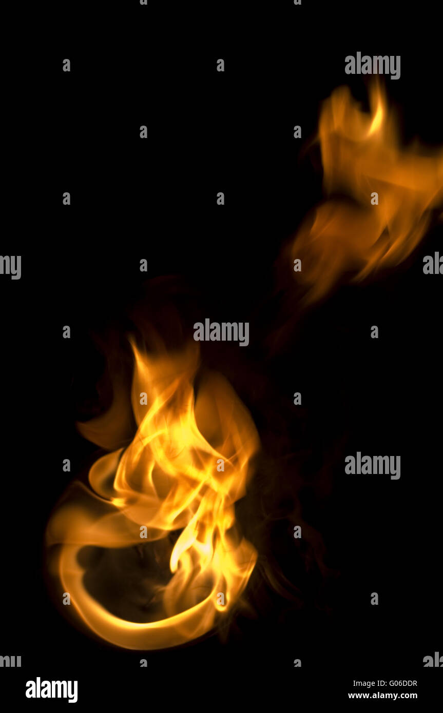 isolated fire flames on black background, darkness - Stock Image
