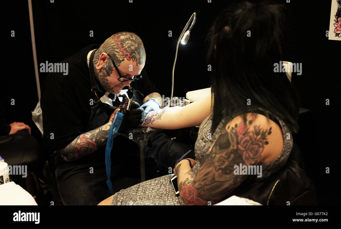 Brighton UK 30th April 2016 - Tattoo artists working at the 9th Annual Brighton Tattoo Convention held in the Brighton - Stock Image