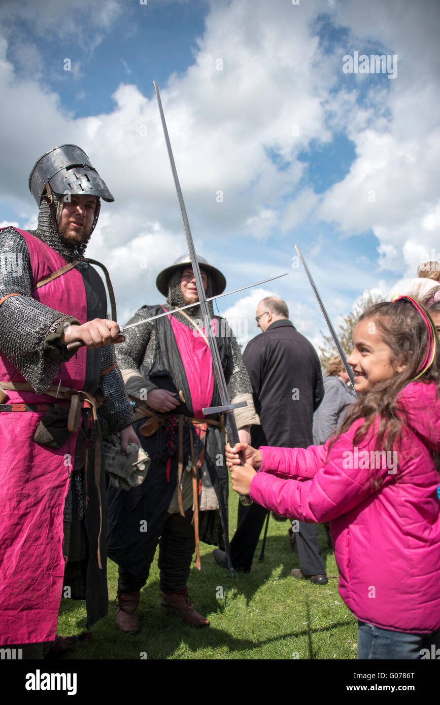 Ely, Cambridgeshire, UK. 30th April, 2016. Girl playing sward fighting with man in medieval armour Credit:  Jason - Stock Image