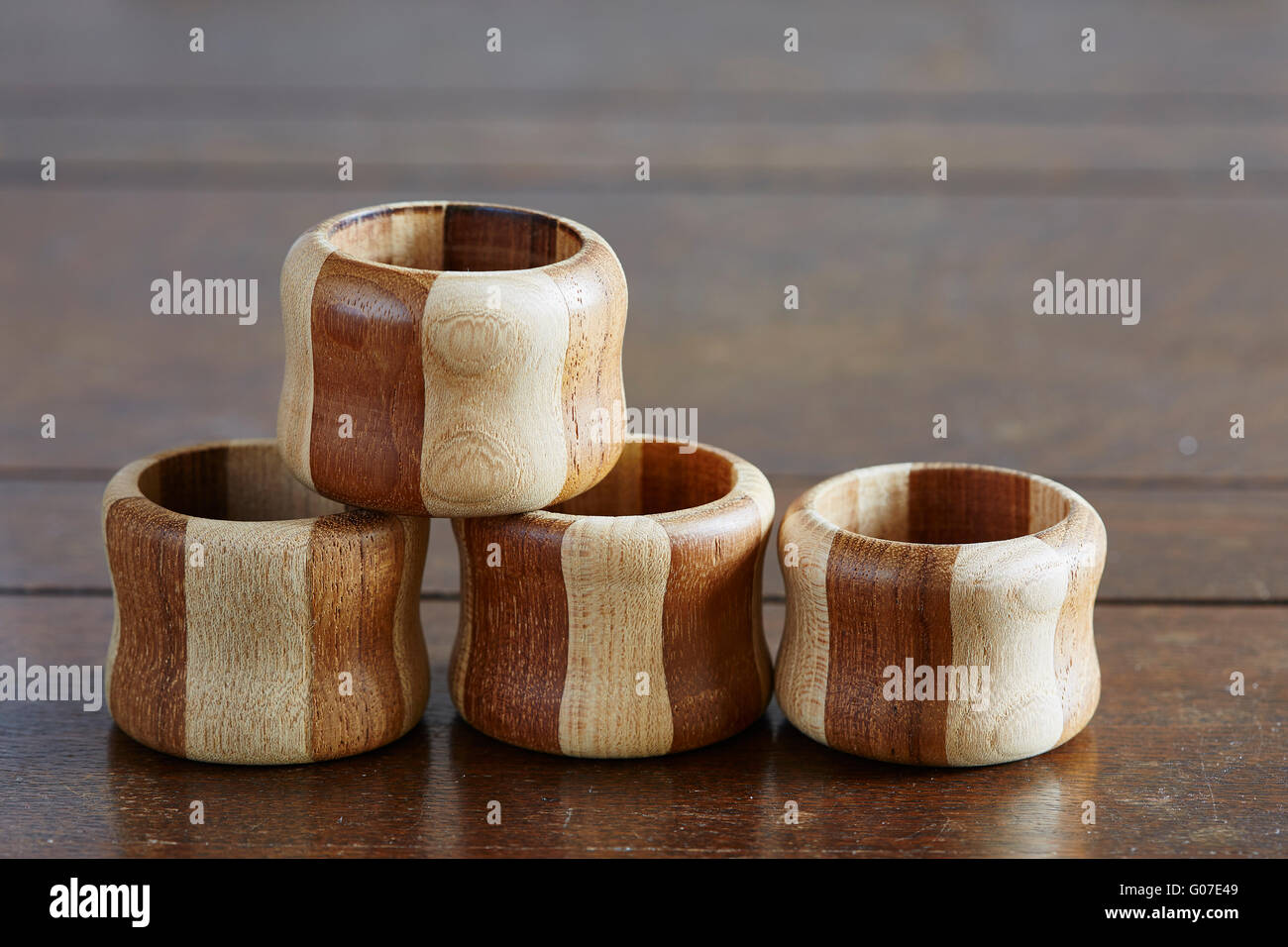Four Wooden Napkin Rings On A Table Stock Photo Alamy