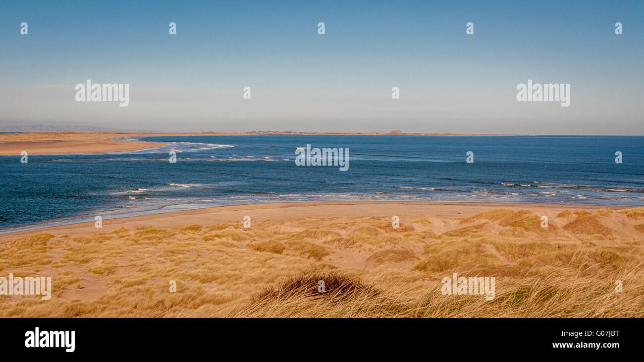 Over the Dunes lies the beautiful bay......... Stock Photo