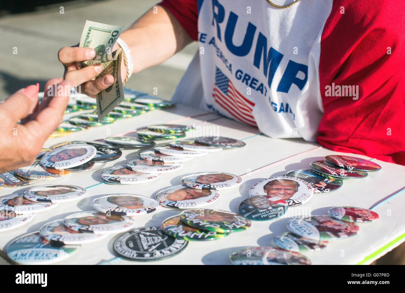 Donald Trump for president campaign badges on sale at a rally in California. - Stock Image