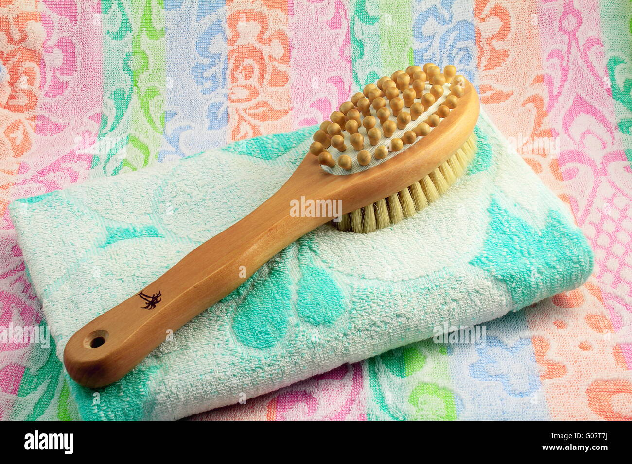 Wooden brush with the handle for massage of a body - Stock Image