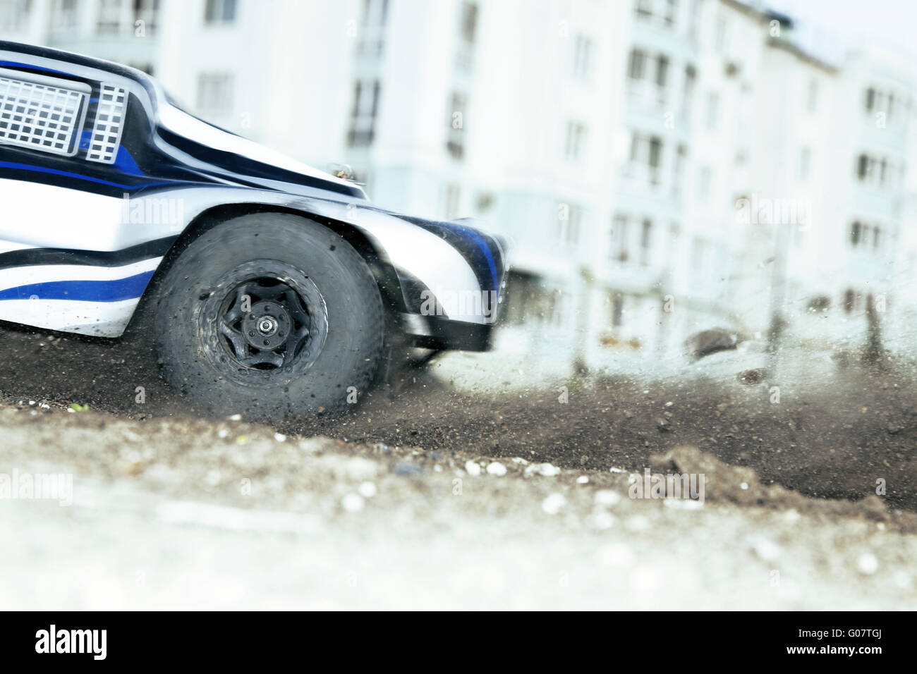 rapidly whirling wheel of a radio-controlled cars - Stock Image