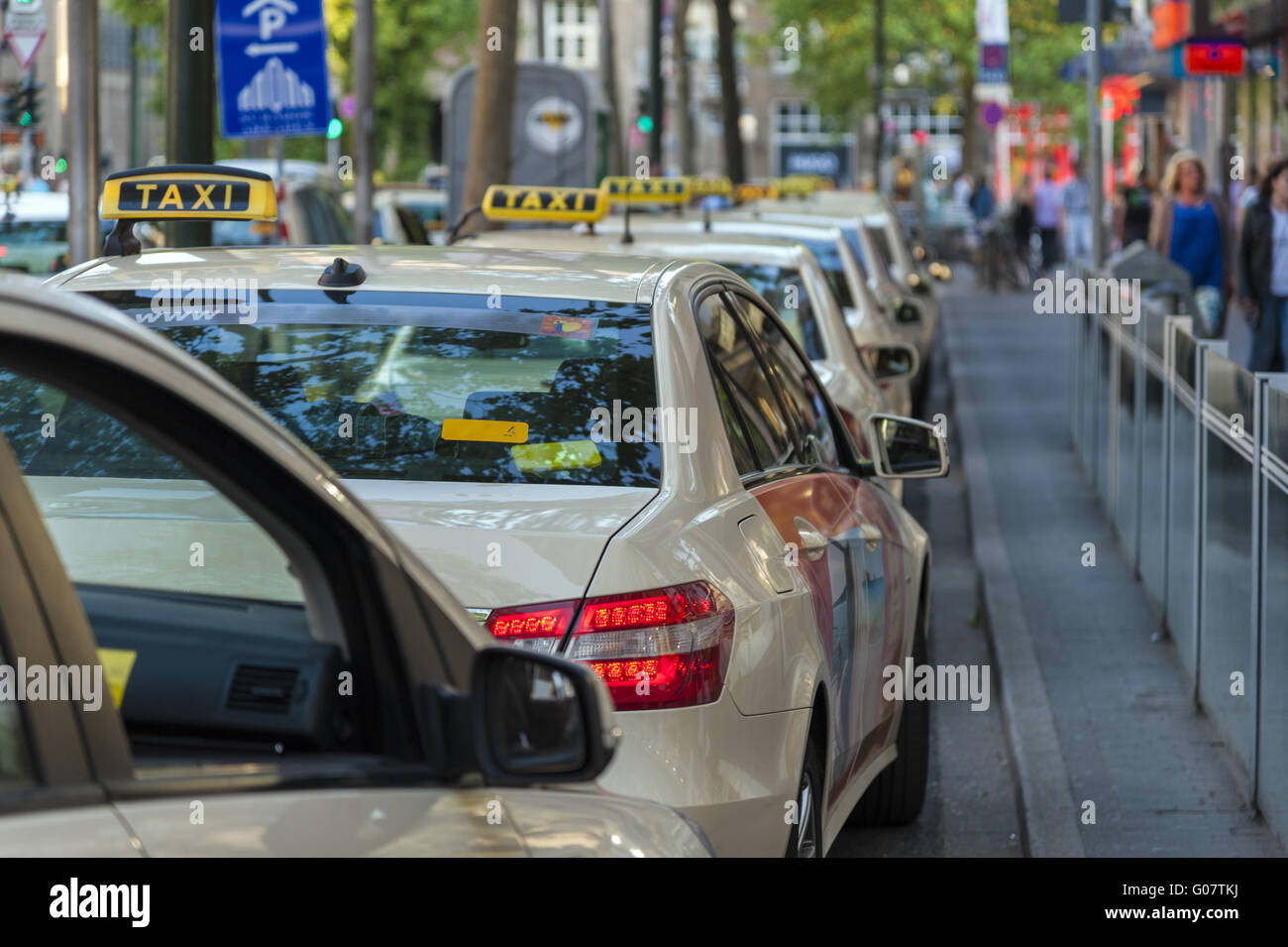 Taxis are one behind the other at a taxi rank - Stock Image