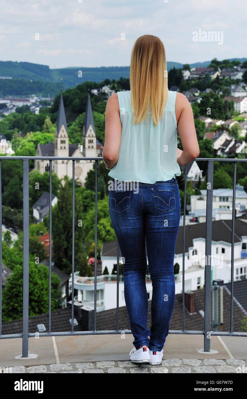young woman in front of the city view of Siegen - Stock Image