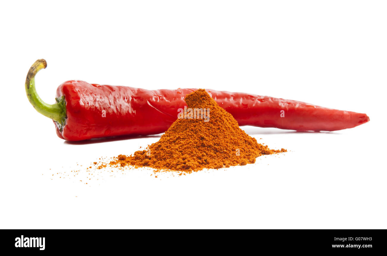 Red chili pepper and pile of red pepper spice - Stock Image