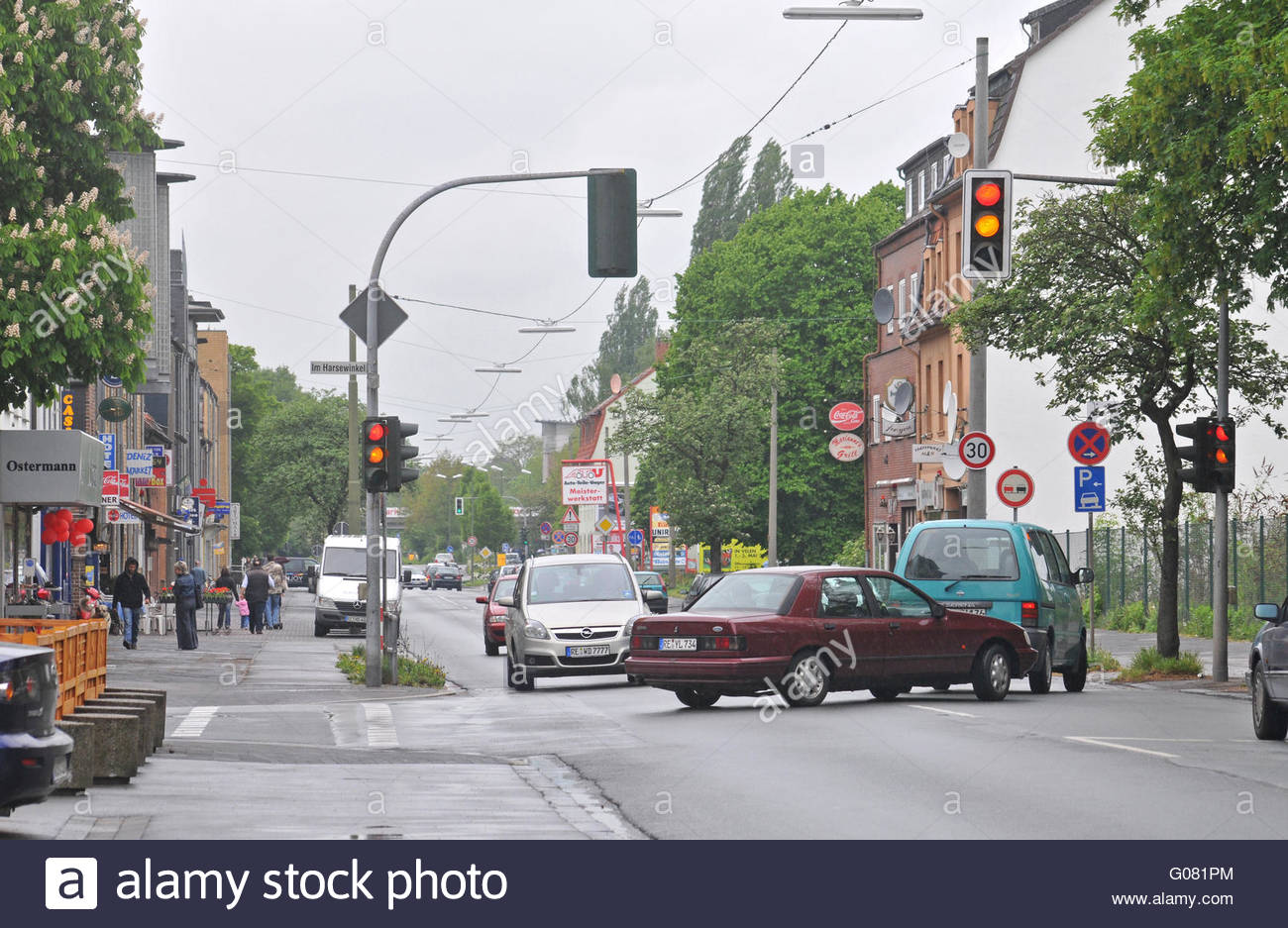 Main road with many shops and diners - Stock Image