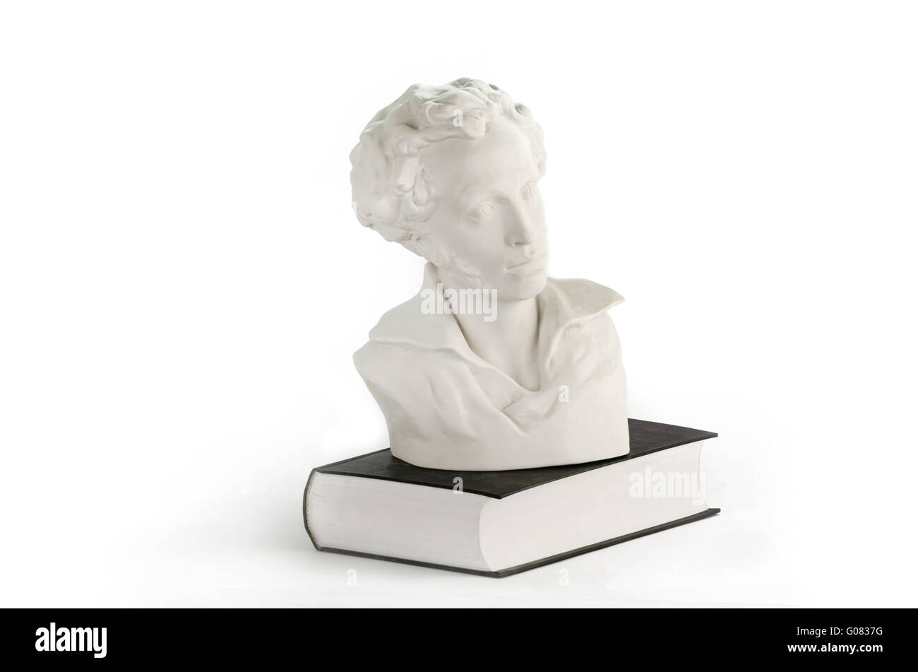 White statue on the book - Stock Image