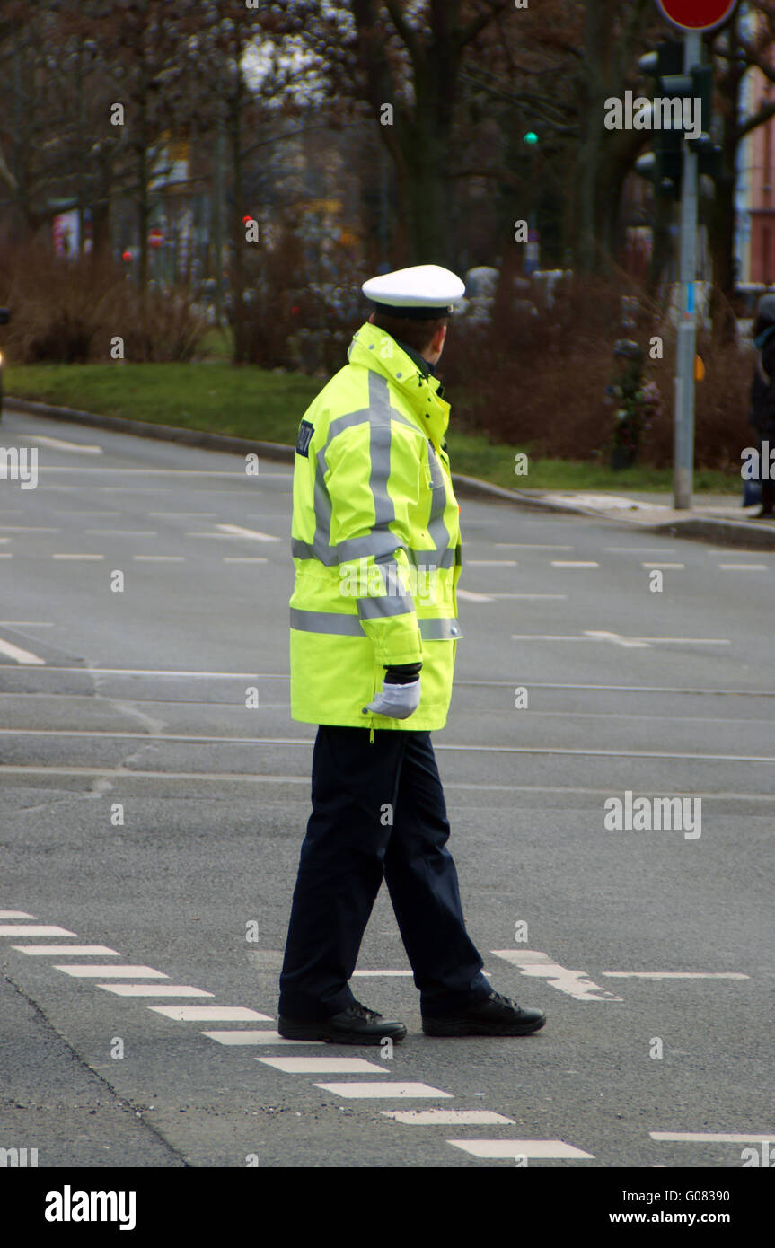 Traffic Police Man at Crossroads - Stock Image
