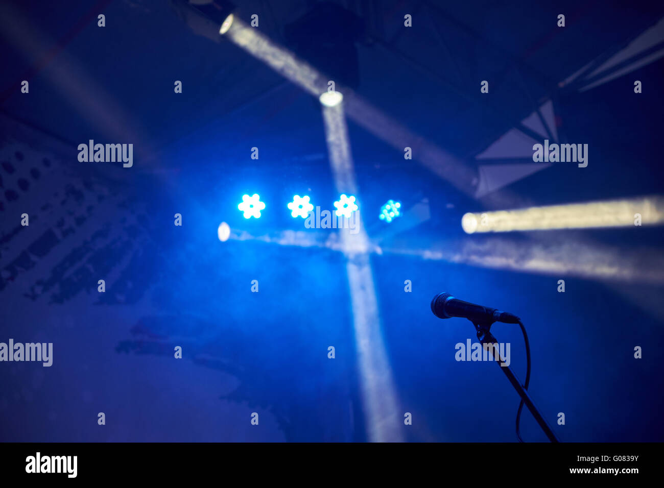 Microphone On Stage With Blue Lights And Fog