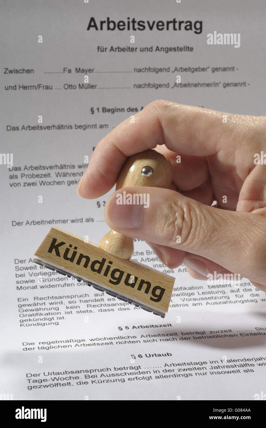 rubber stamp over contract marked with dismissal Stock Photo