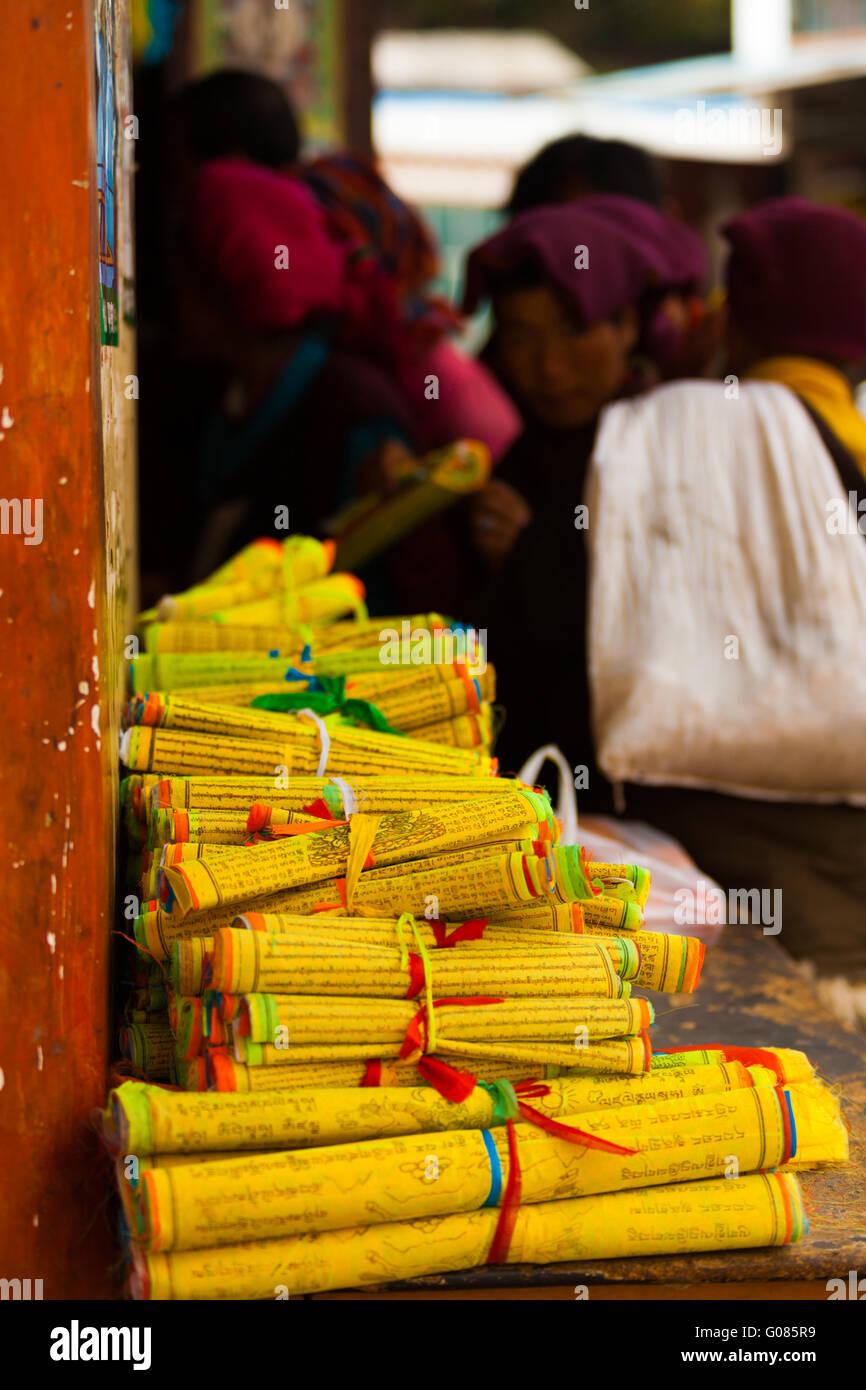 Yellow Tibetan Prayer Scrolls Text Monks Buying - Stock Image