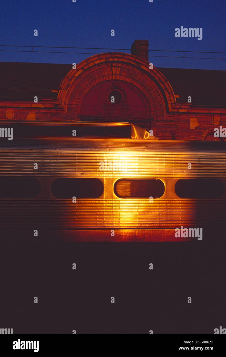Setting sun reflects off of SEPTA commuter train car - Stock Image
