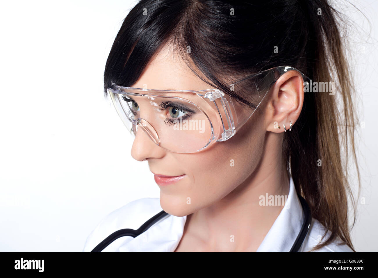 Portrait of female doctor with protective glasses Stock Photo
