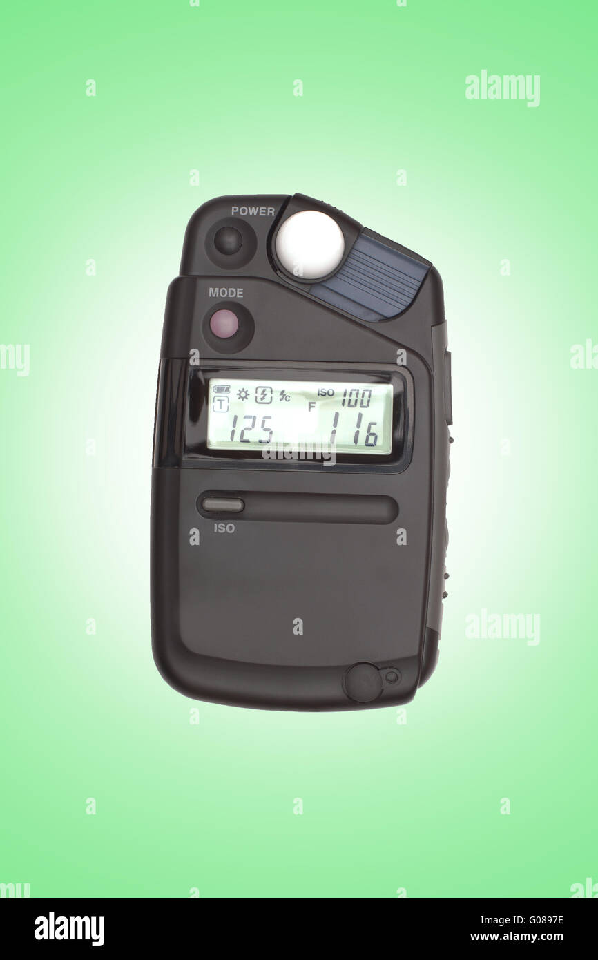 Digital flashmeter, isolated on green backrgound - Stock Image