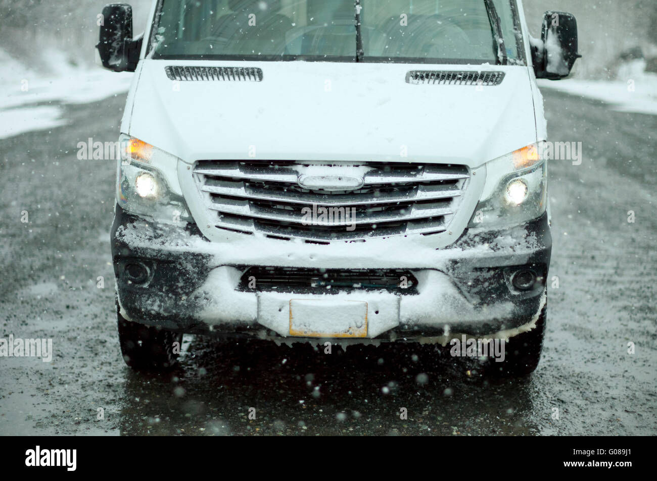 Sprinter Van by Freightliner in winter driving conditions in the back roads of Alaska - Stock Image