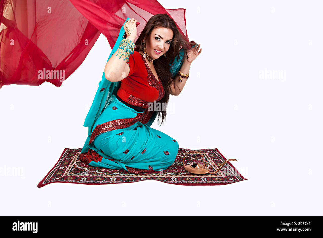 Beautiful young indian woman sitting on a flying c - Stock Image