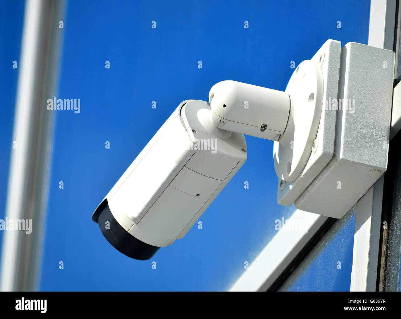 Surveillance camera outdoors on a modern glass fac - Stock Image