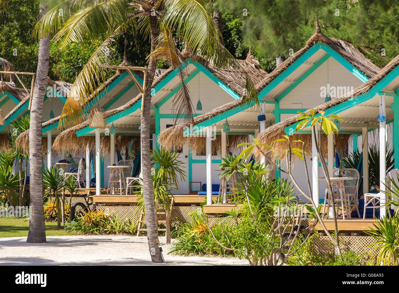 Tropical beach bungalow on ocean shore, Gili Meno, Lombok, Indonesia - Stock Image