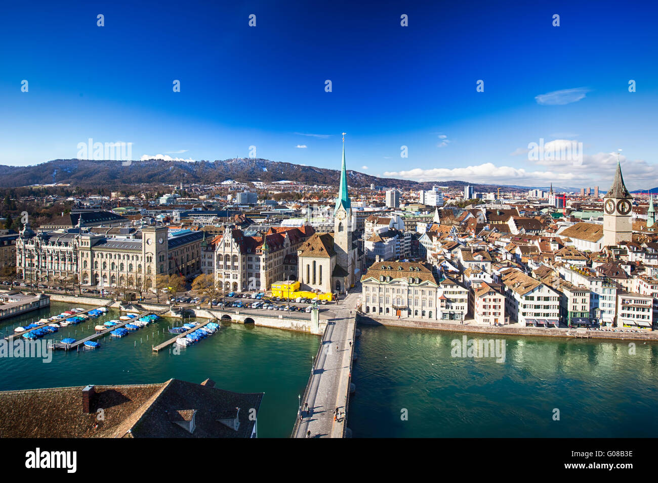 ZUERICH, SWITZERLAND - February 11, 2016 - View of historic Zurich city center with famous Grossmunster Church and - Stock Image