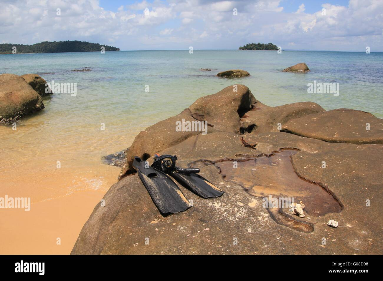 Fins at the beach on Koh Rong/ Monkey Island - Stock Image