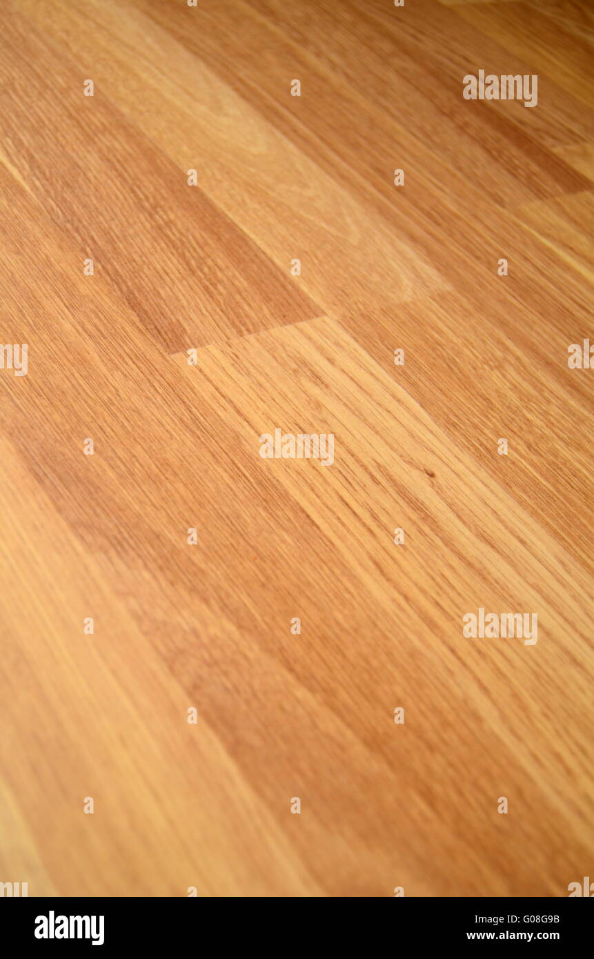 Background Texture of Laminate Wooden Floor With Shallow Depth Of Focus - Stock Image