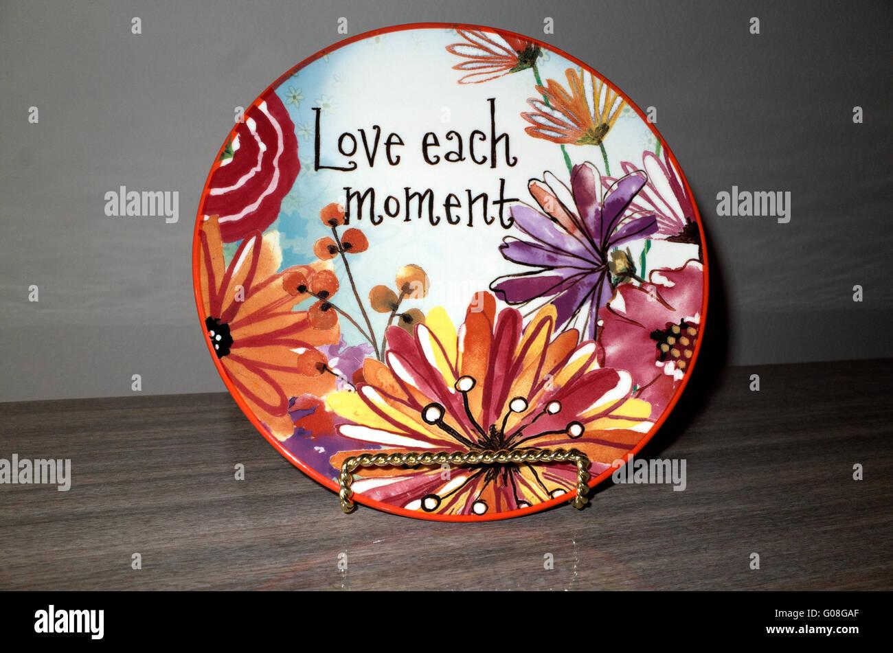 Love Each Moment stoneware salad plate. St Paul Minnesota MN USA - Stock Image