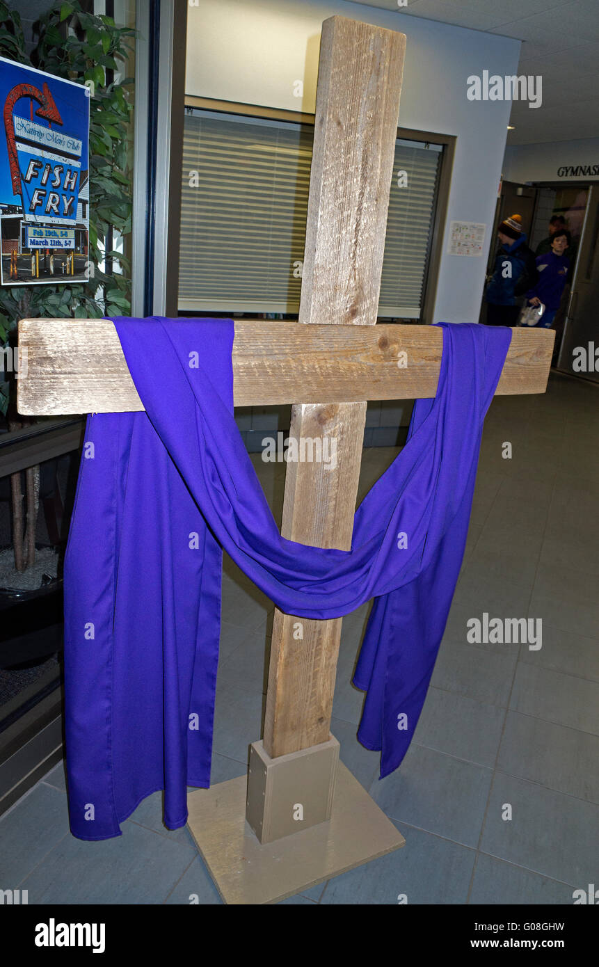 Easter Draped Cross in hallway of Nativity Catholic grade school. St Paul Minnesota MN USA - Stock Image