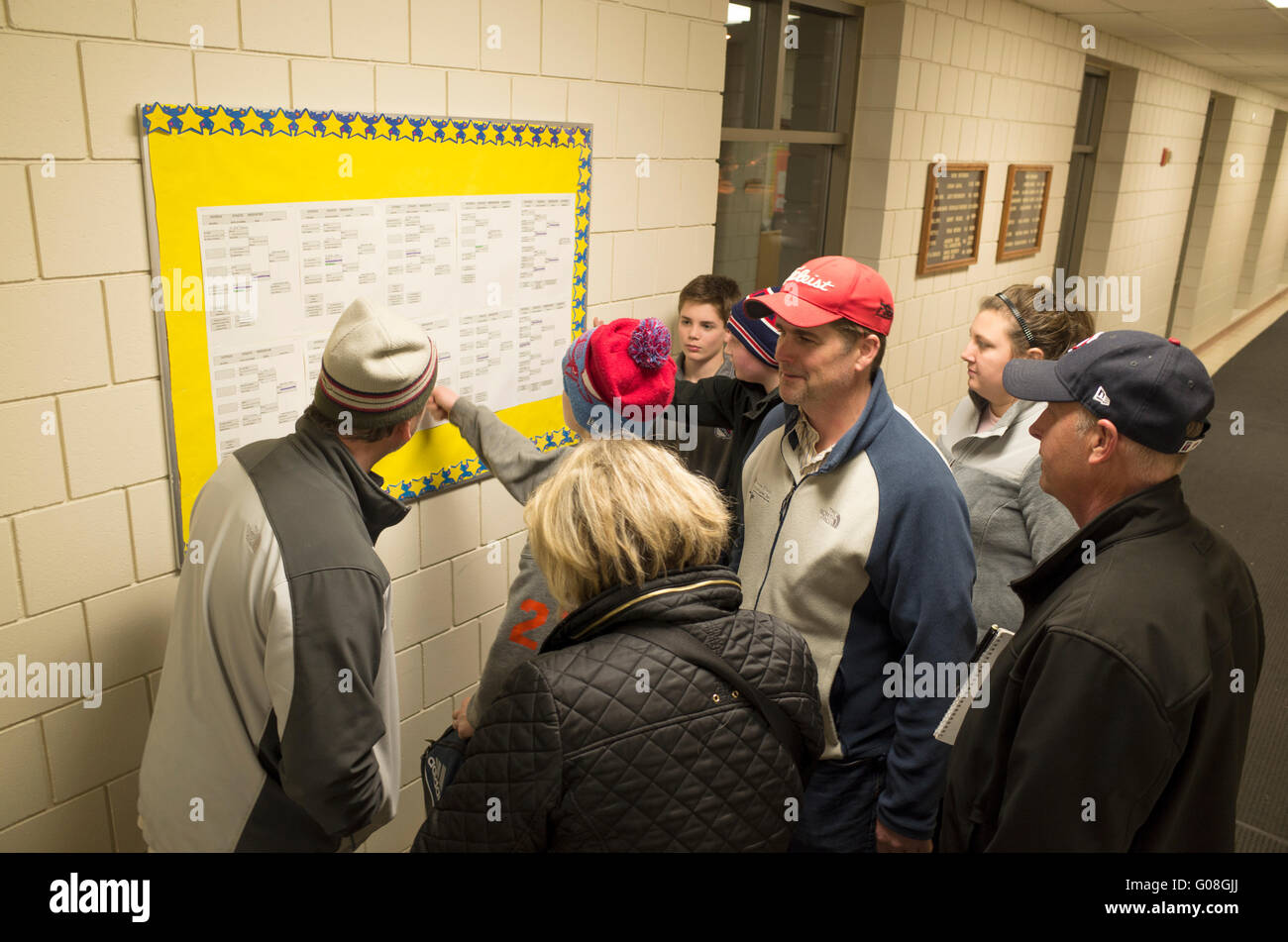 Parents and players gathered around tournament bracket win-loss playing schedule. St Paul Minnesota MN USA - Stock Image