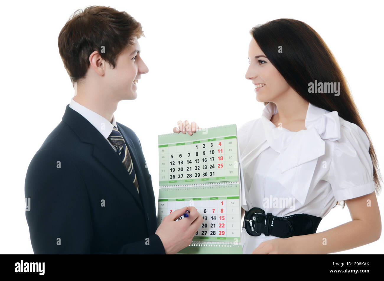 The businessman and businesswoman hold calendar - Stock Image