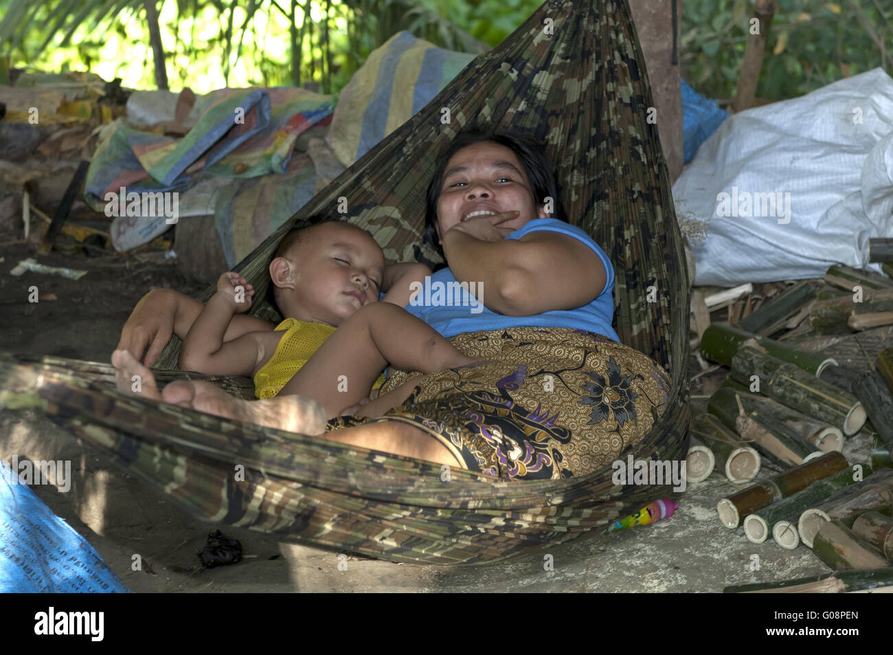 Mother with sleeping toddler in a hammock Stock Photo