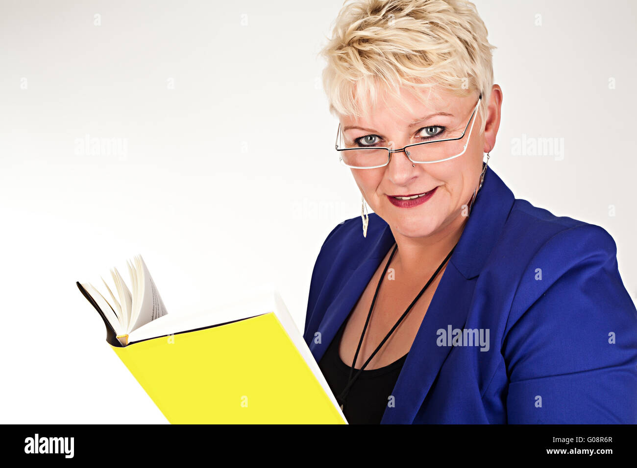 middelaged business woman in jacket with glasses r Stock Photo
