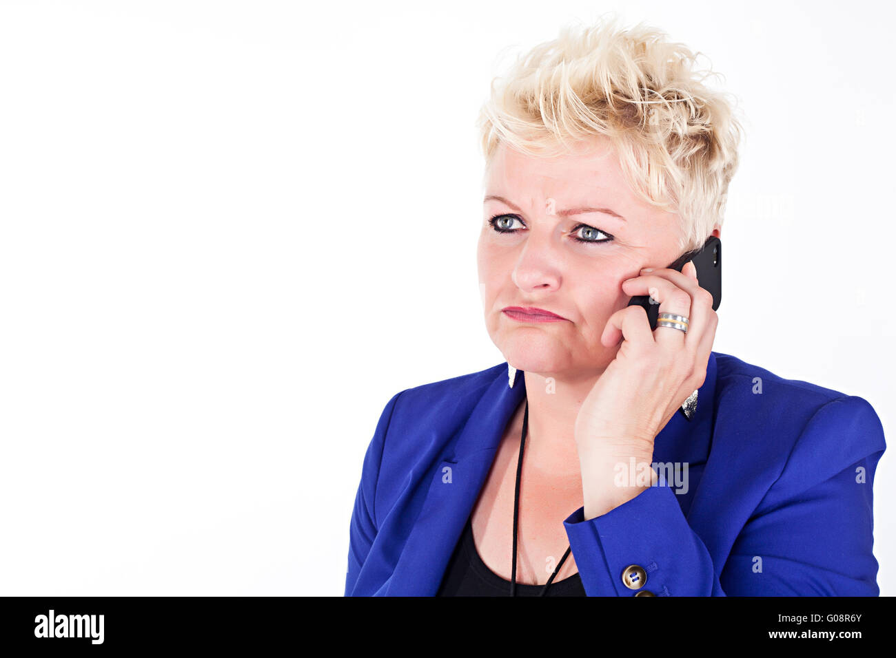 middelaged business woman in jacket talking on the Stock Photo