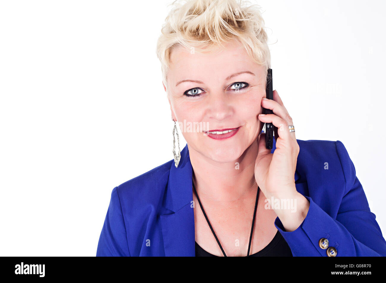 middelaged business woman in jacket talking on the - Stock Image