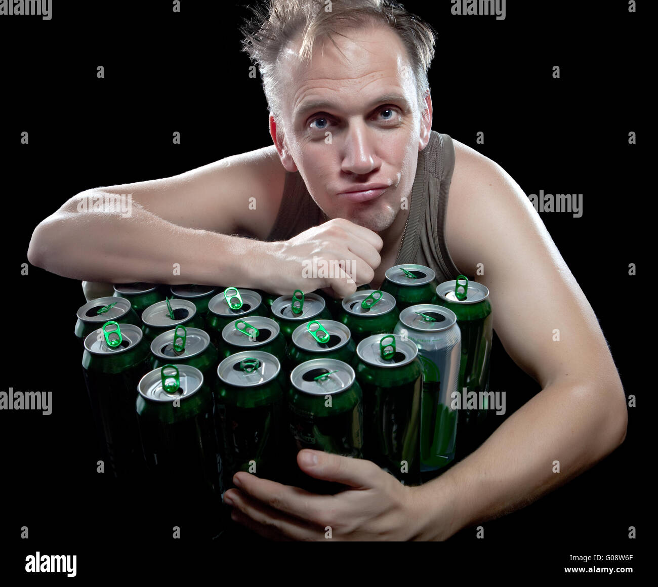 The drunk man and is a lot of empty beer cans - Stock Image