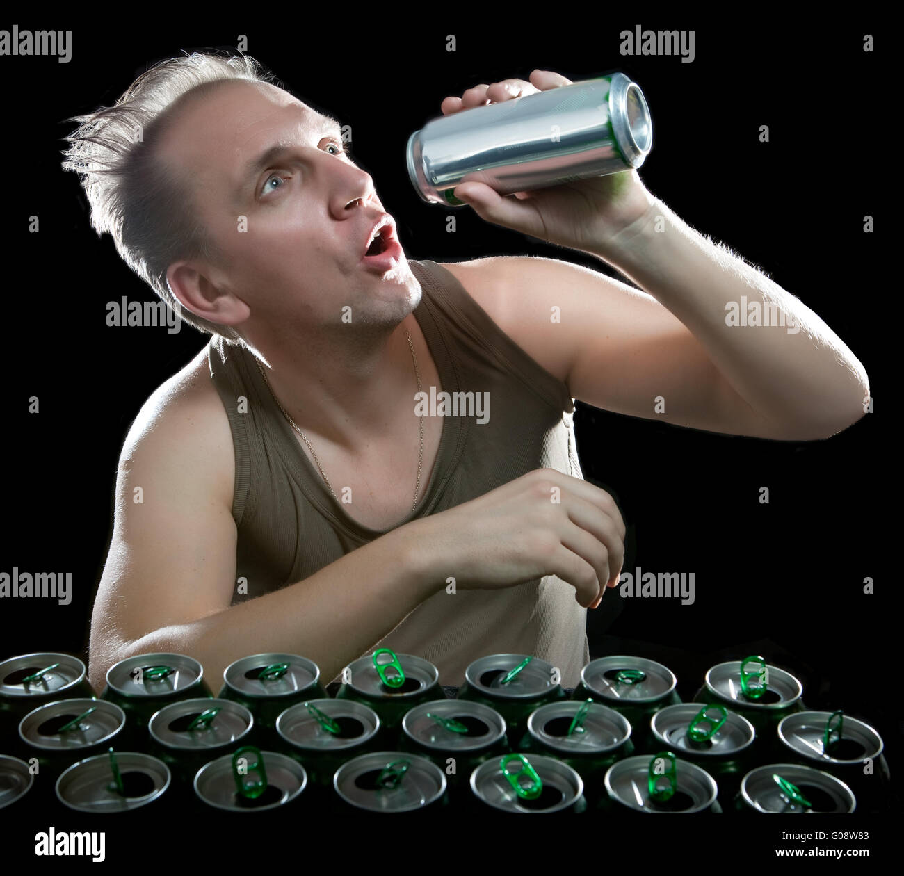 The man wants to drink the last drink of beer - Stock Image