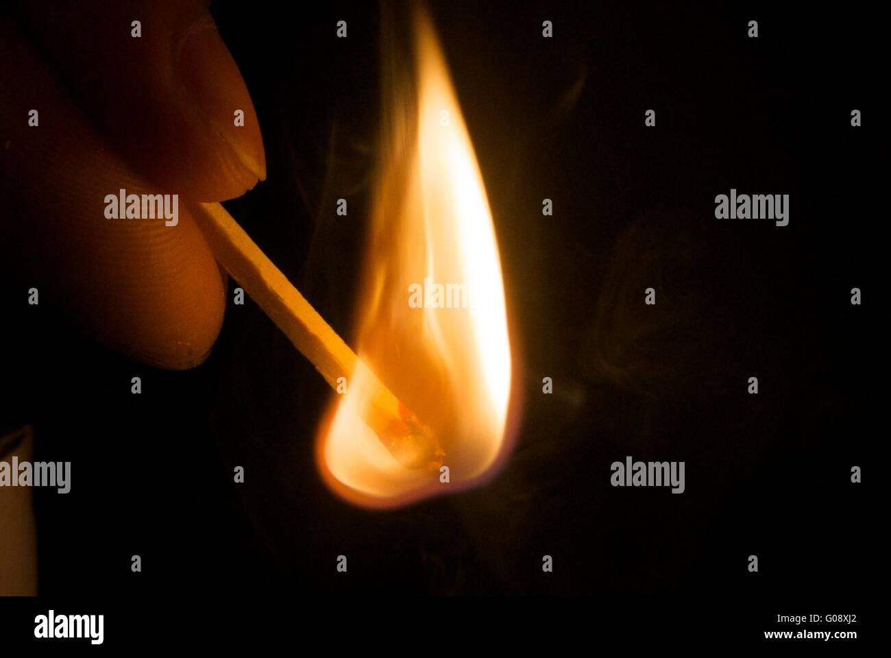 burning matchstick - Stock Image