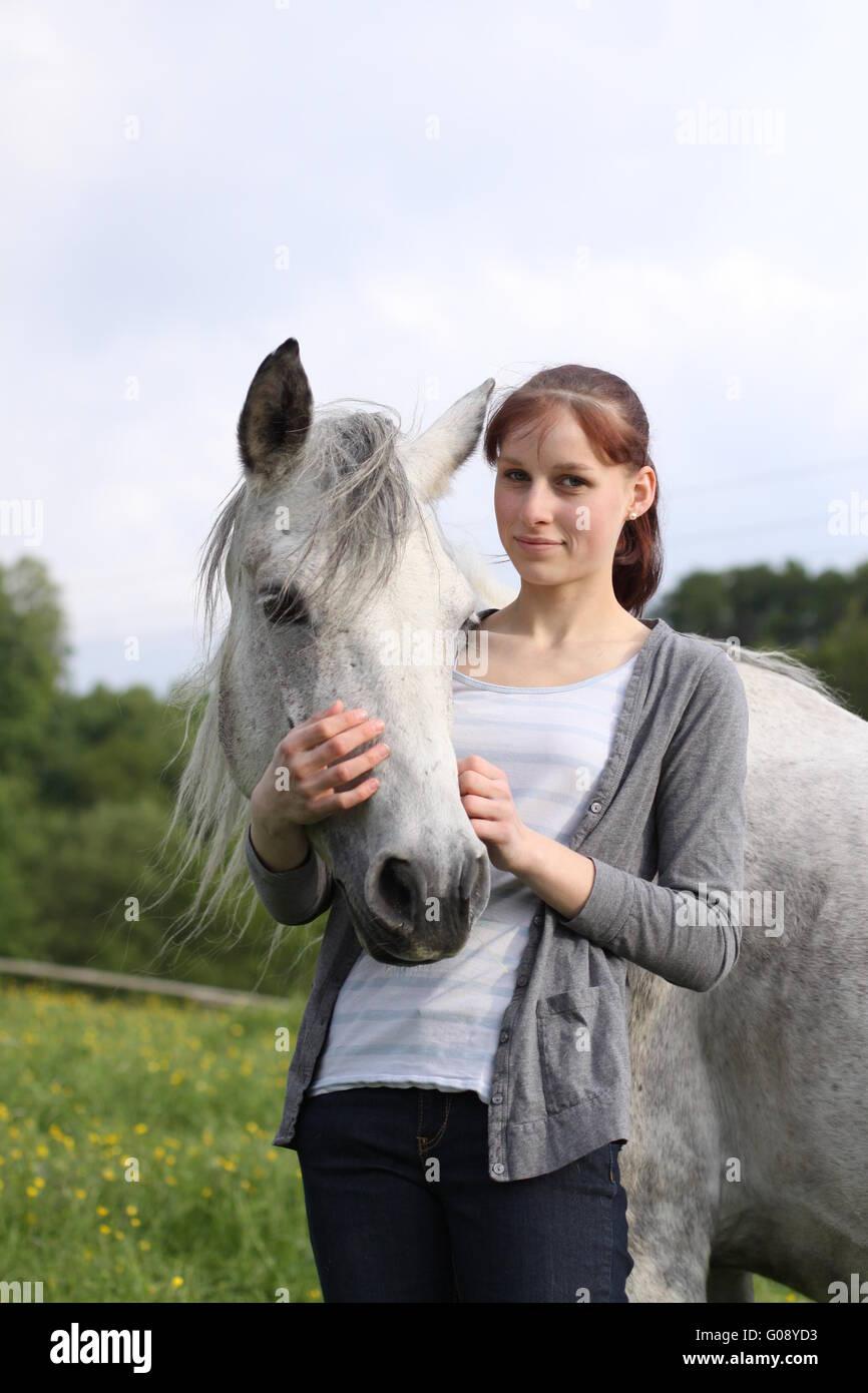 Girl and Connemarapony Stock Photo