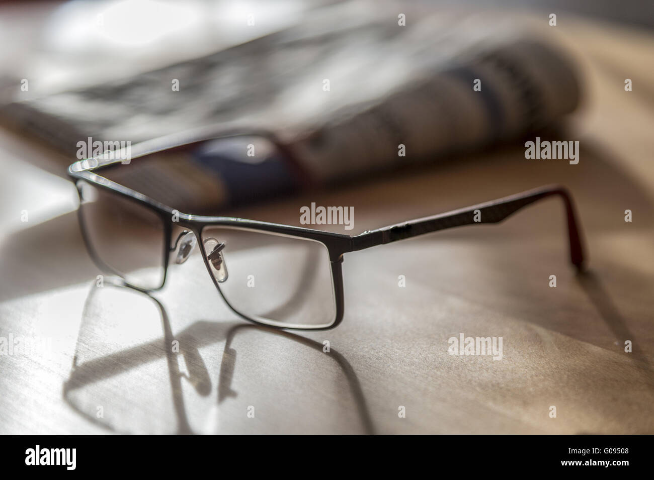 Glasses and newspaper - Stock Image