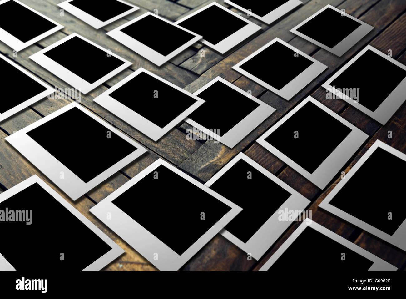Polaroid films on the wooden floor - Stock Image