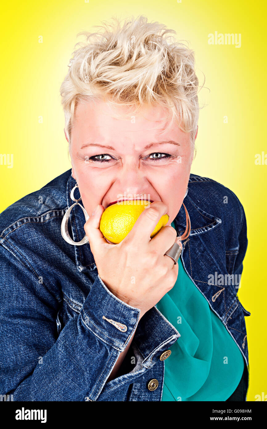 Portrait of middelaged beautiful woman eating fres Stock Photo