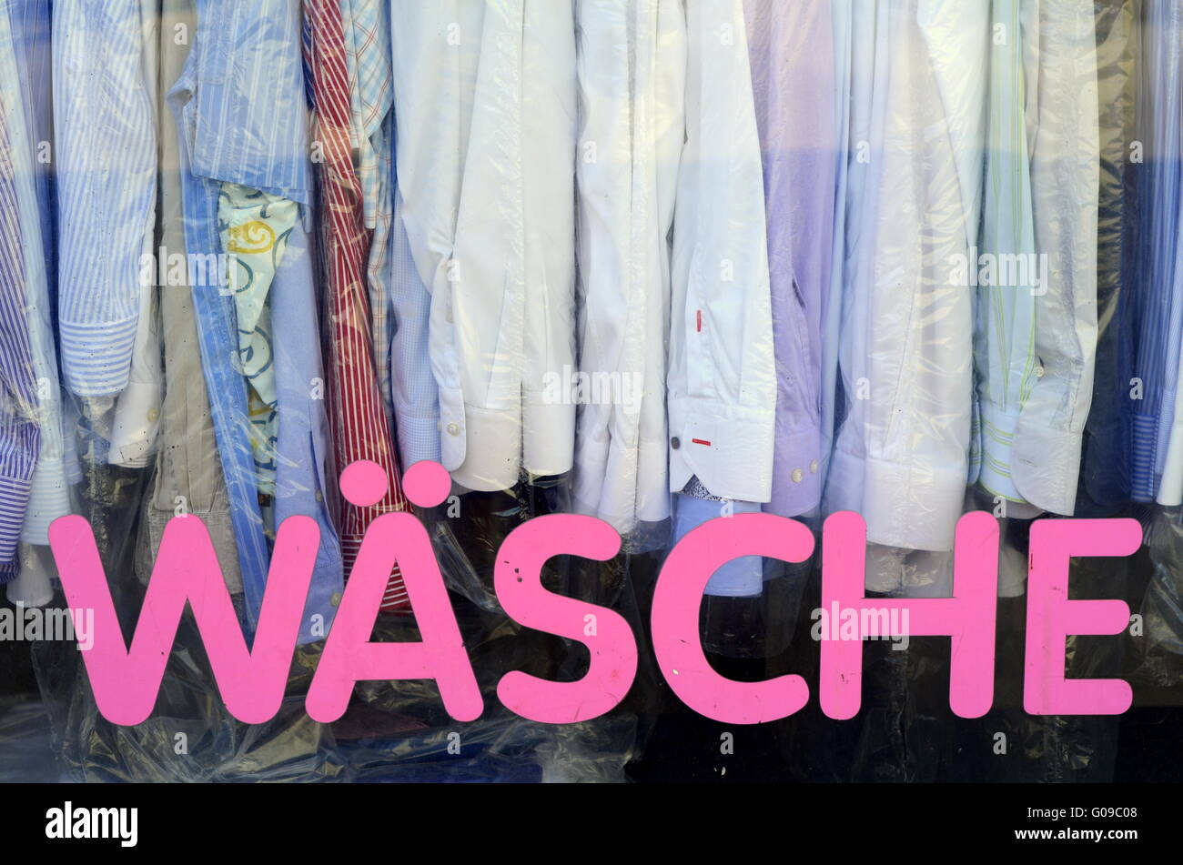 Sign And Shirts In The Window Of A Vintage German Laundromat Stock Photo