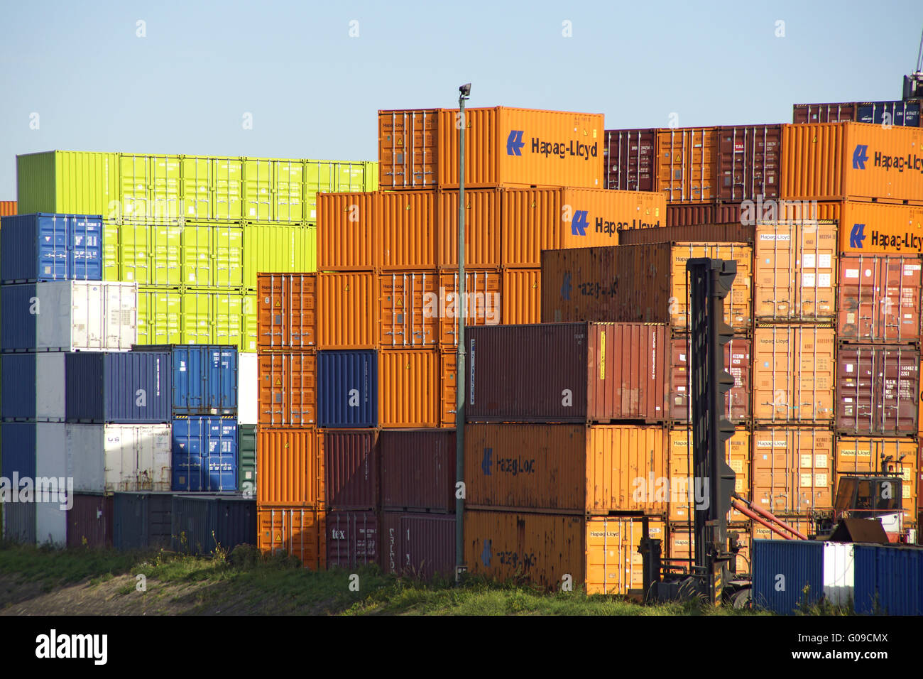 Stack of container in the harbor of Rotterdam - Stock Image