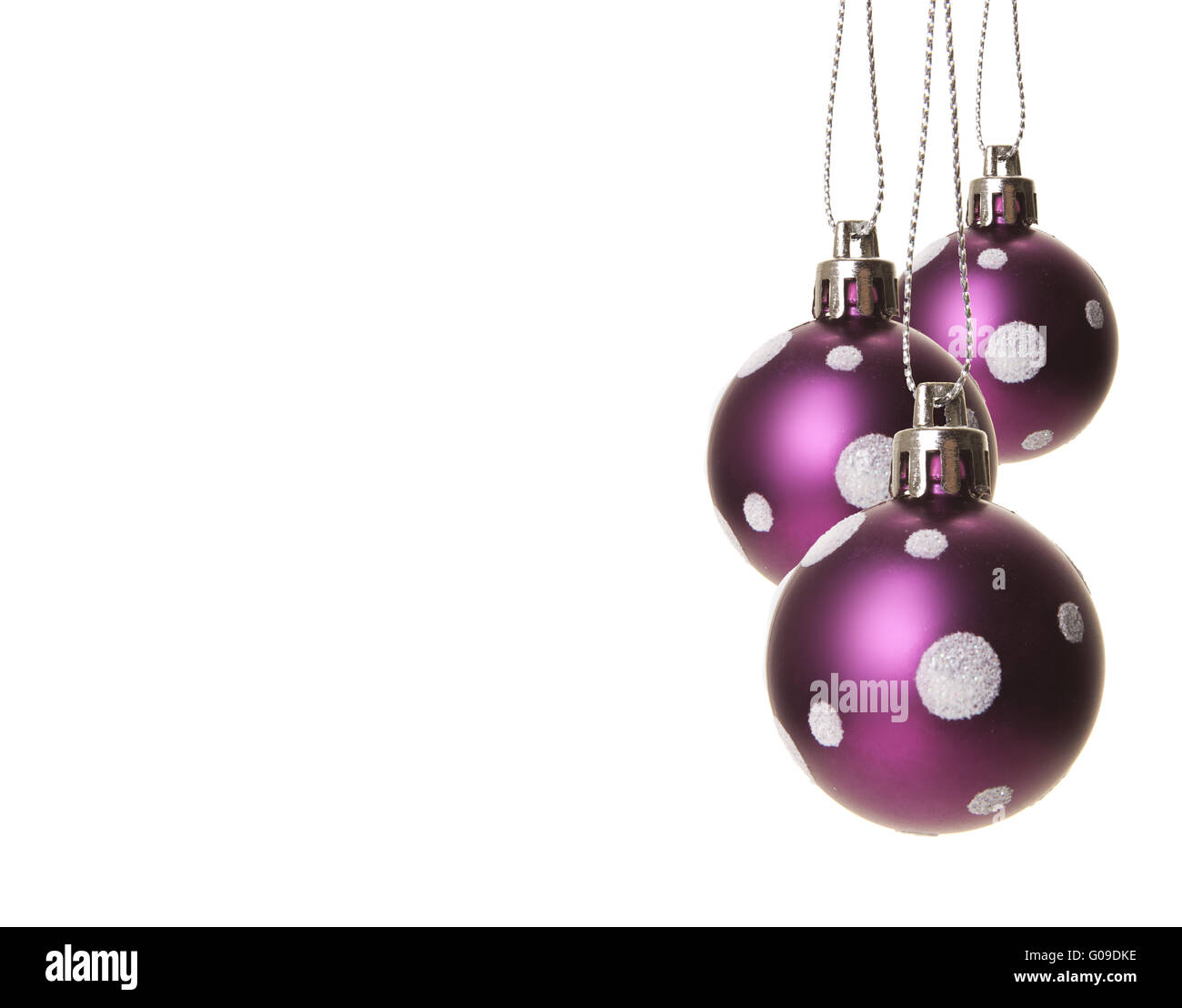 purple christmas balls with white pattern isolated - Stock Image