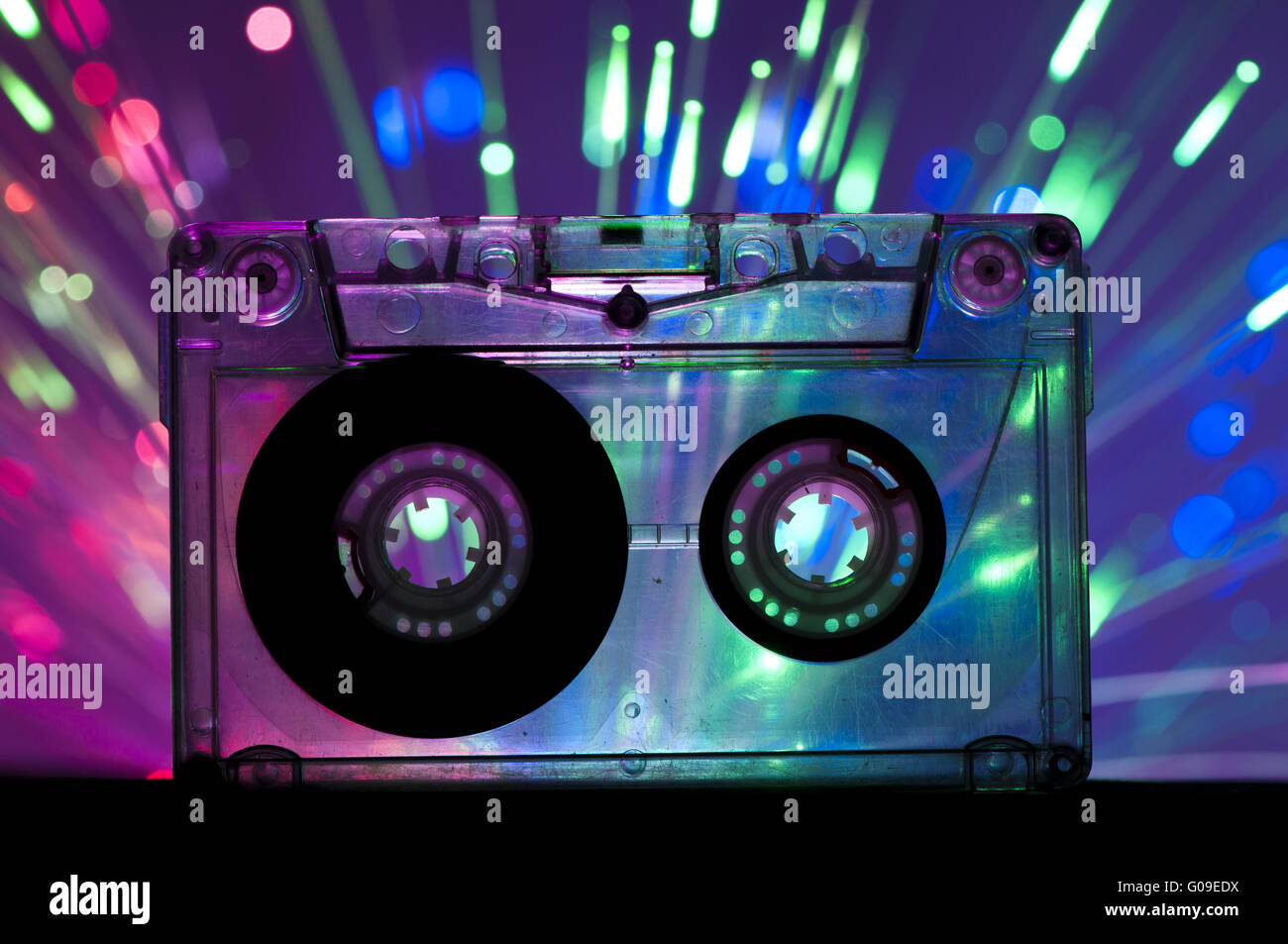 Transparent Cassette tape and disco light background - Stock Image
