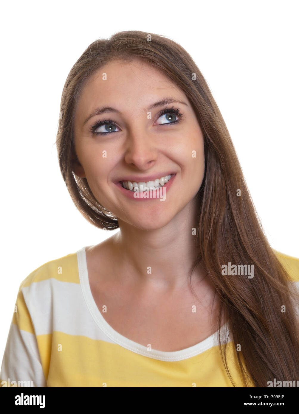 Portrait of a laughing woman with long brown hair - Stock Image